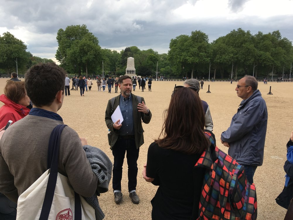 Professor Coll Thrush addresses a walking tour In London.