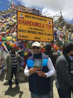 International businessman Vinod Rangra reading The Oasis Within in the Himalayas, at over 18,000 feet. Cultivating his own oasis.