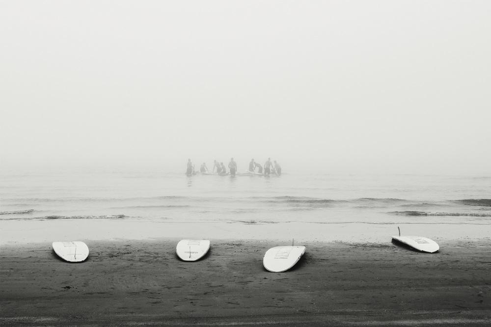 Lifeguards spending the foggy morning training off the Gulf Coast in Galveston Beach, TX.