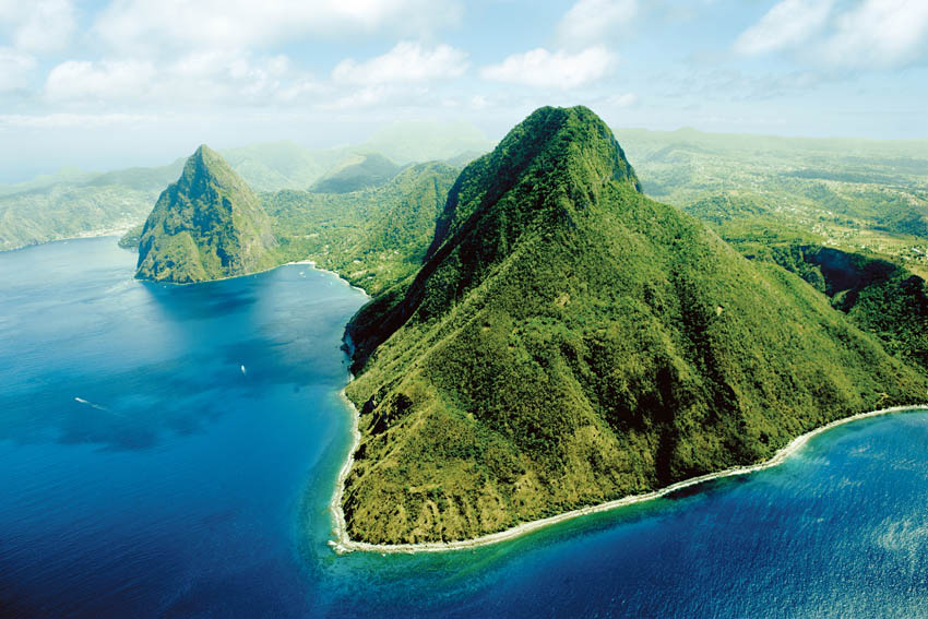 // The Pitons →<p>Soak in the beauty of this world heritage site from the boat, or hike 2,500 ft to the volcanic peak.</p>