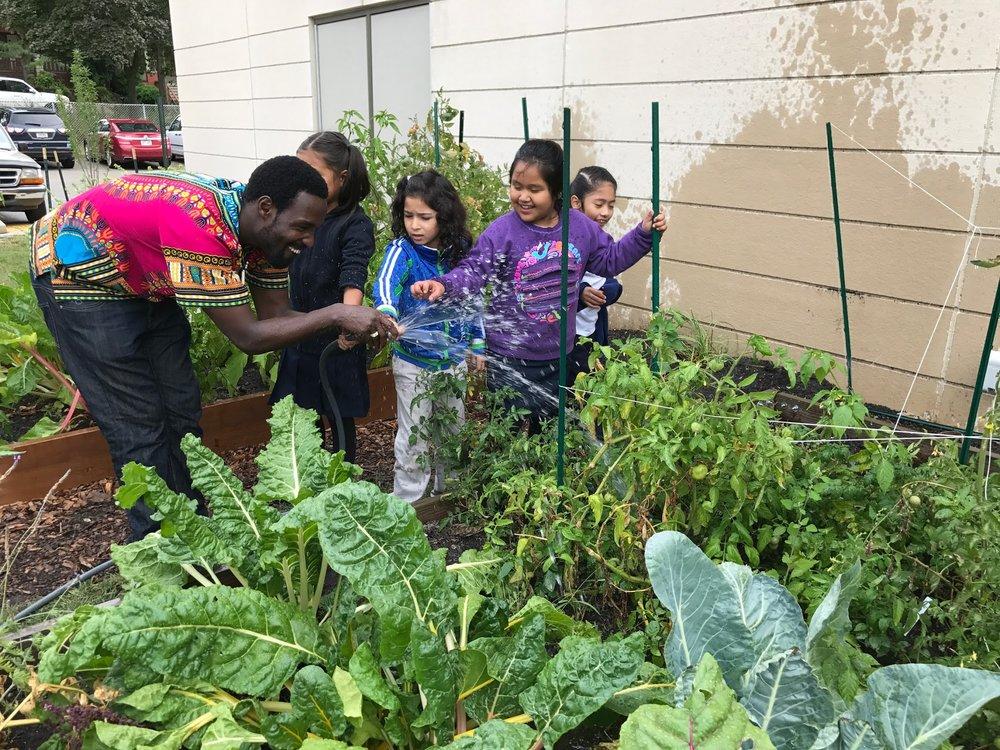 Longfellow students watering garden.JPG