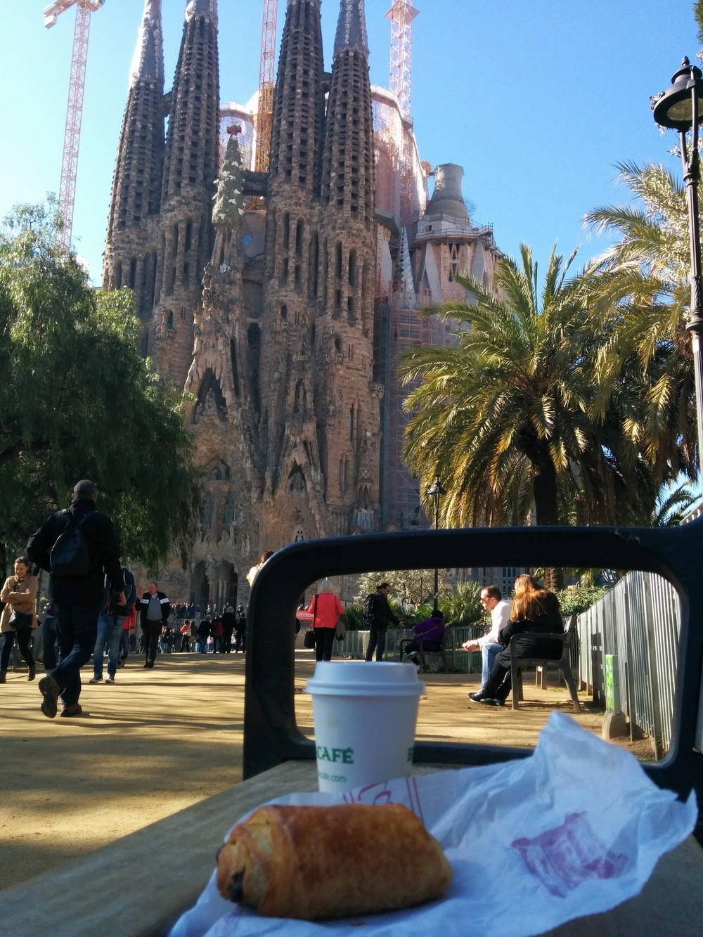 One of my chocolate croissant and coffee breaks in front of the Sagrada Familia