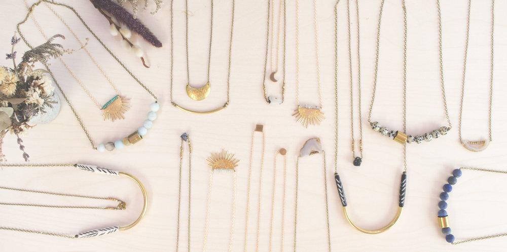 A necklace flat lay that includes almost one of everything from our line