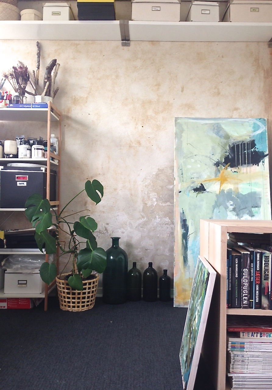A peak inside her studio space. Lot's of room for storage and books.