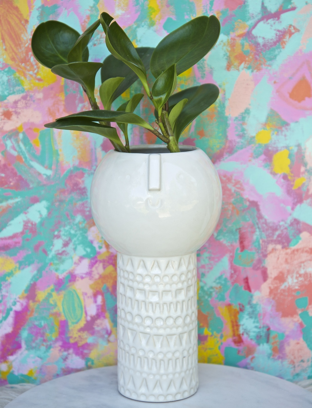 "Established in 2012, Atelier Stella is an ever changing collection of unique ceramics hand made by Stella Baggott in Brighton, England. I purchased this amazing vase at West Elm, its got a retro vibe that I adore. I love how they collaborate with artisans and makers all over the world. It's already found a new home in our living room.  ""My work is modern, stylish and brings a smile! I lovingly design, hand build, fire in my kiln and glaze small batches of work to give you a truly unique, one of a kind work of art, so if you like a piece grab it while you can! I design pieces for those who like vintage finds."""