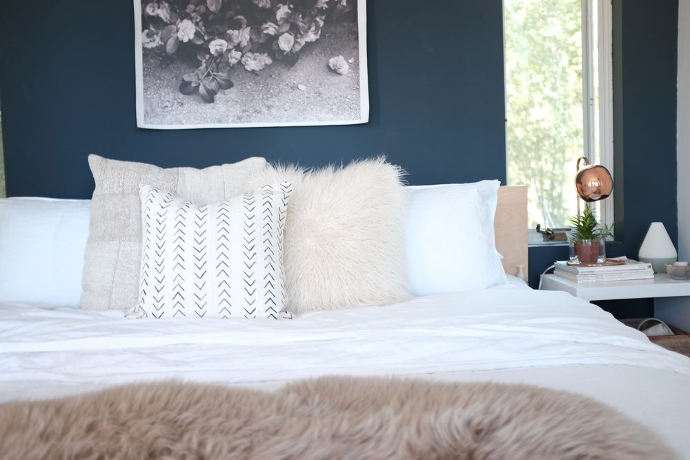 Layered textiles help add that coziness Kim loves.