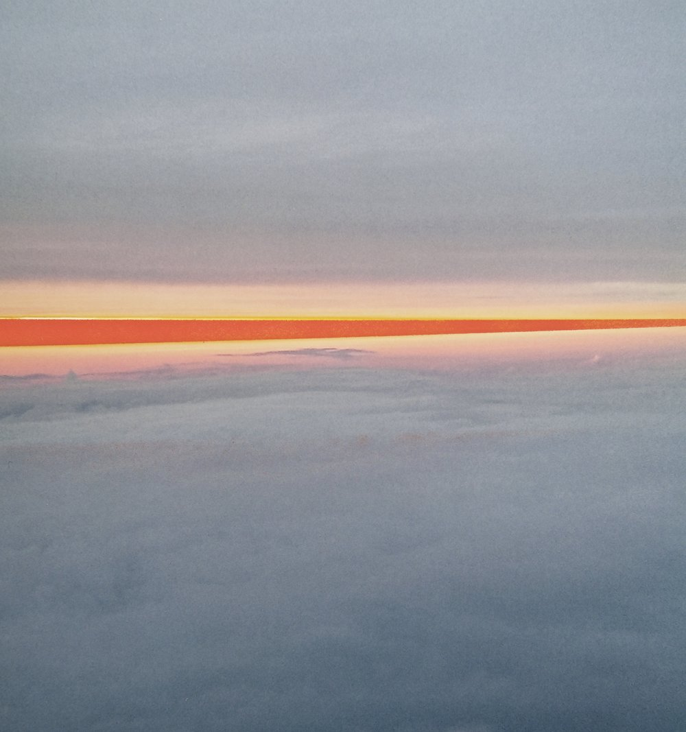 A photo taken from the plane on my recent trip to Boston. Right now I'm into landscapes with fluffy clouds that have a daydream blurriness to them.