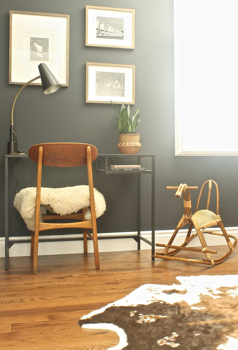 """Fast-forward to today, after forcing black paint [Benjamin Moore Wrought Iron] on my boyfriend, and the office is complete."""
