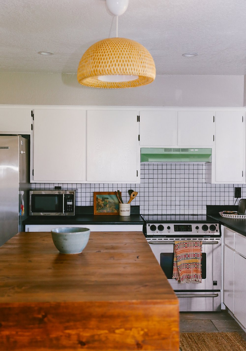 Kate spray painted the range hood green. An inexpensive way to add a vintage element to your space.