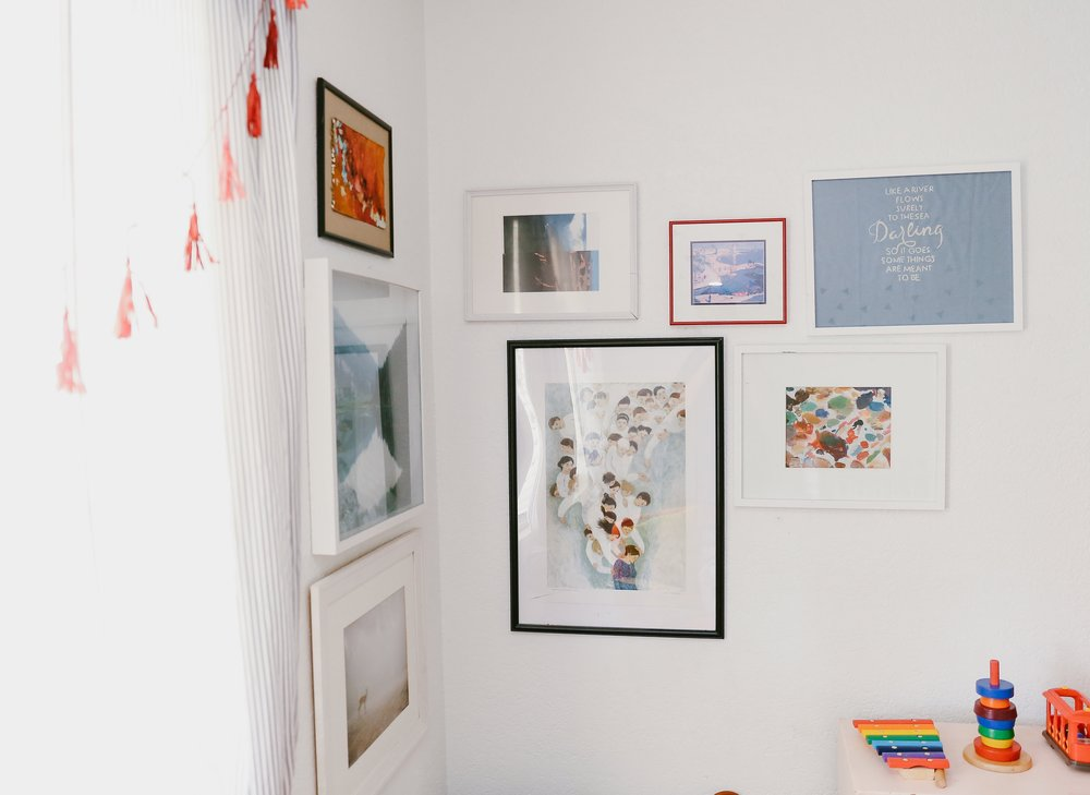 Kate's favourite Brian Kershisnik print (in the black frame) hangs amongst some of her photography in this corner gallery wall.