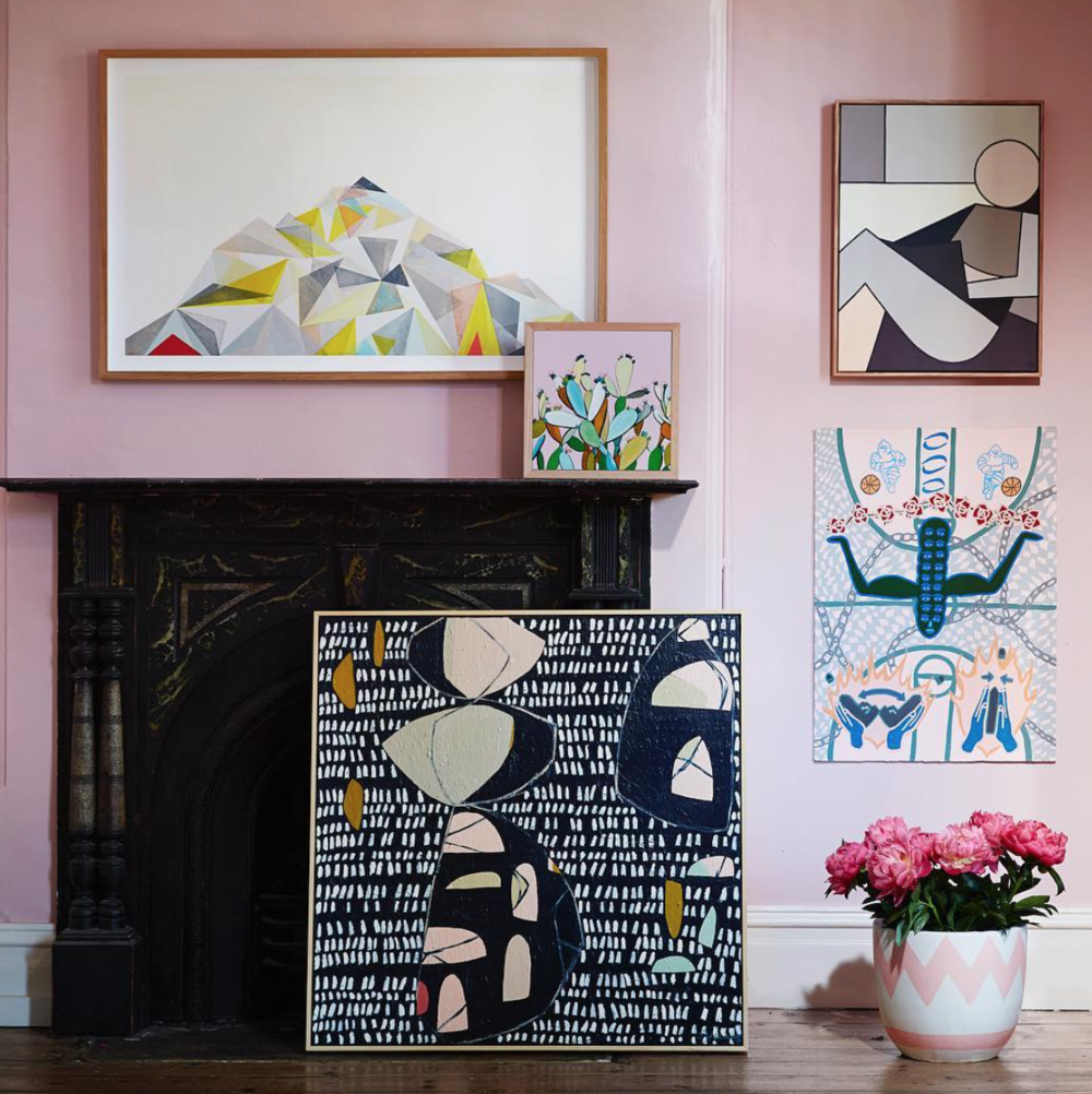 The painting leaning against the fireplace is by artist Carly Williams. Some elements in her work remind me of the mobiles by Alexander Caldwell. The small cactus piece on the mantle is by the talented Kate Jarman.