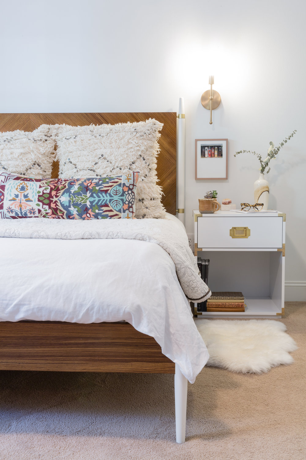 The master bedroom is kept neutral with lots of texture. How stunning is this bed from Anthropology!