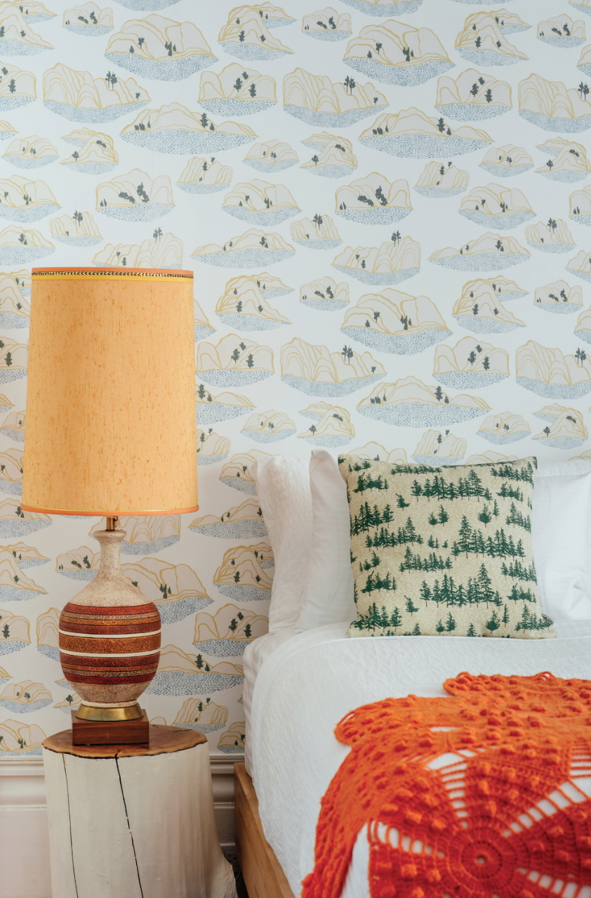Here is Kate's Sand Dunes wallpaper pattern. The Chuckery Hill pattern is shown on the toss cushion. Photo by Johnny C Y Lam.