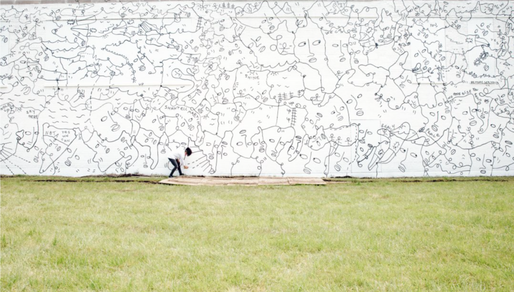 Shantell Martin working on her mural, Dance Everyday, 2017, at 537 East Delavan Avenue. Photograph by Connie Tsang.