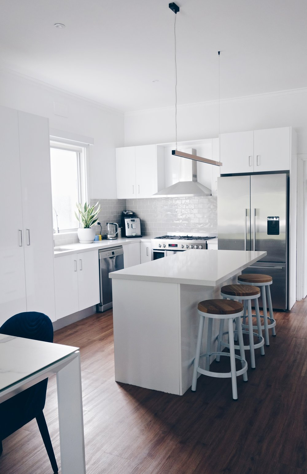 The modern kitchen provides a great spot for Adrian to entertain & cook for his friends. I really like the subway tile backsplash he has chosen. It's neutral &creates texture when the light hits it. You can't go wrong with white cabinetry.