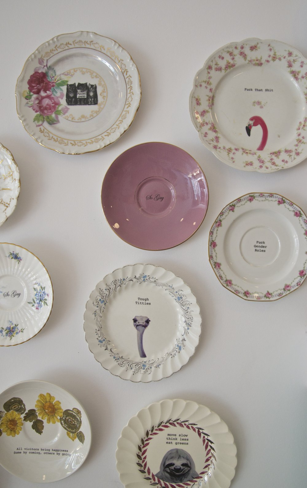 The plate wall by Lou Brown Vintage is so fun!