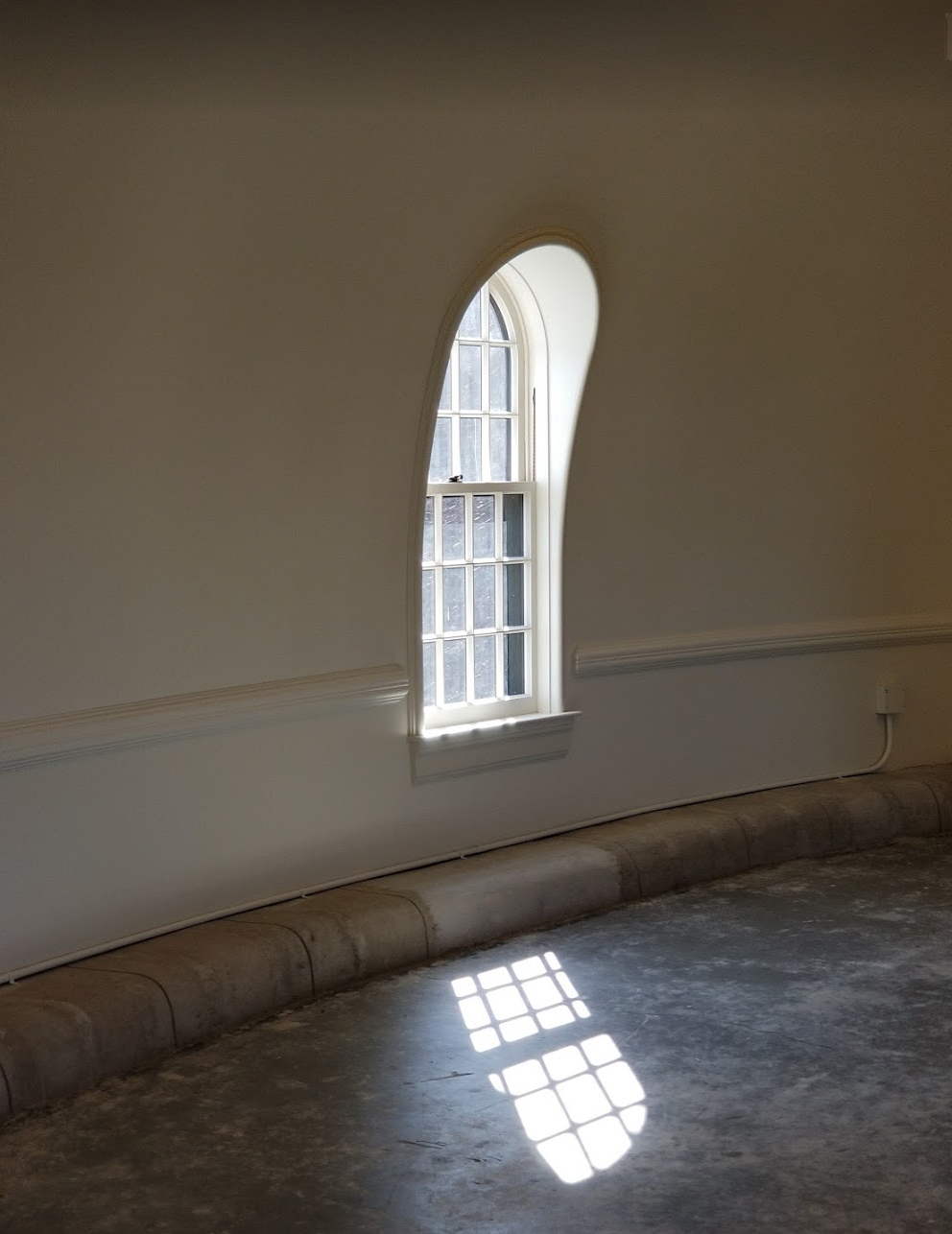 This window reminded me of The Handmaid's Tale. I love the light & simplicity is the hallway.