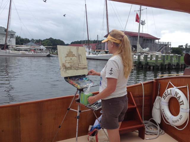 Debra painting in St. Michael's, MD from the Historic Catboat, Selina.