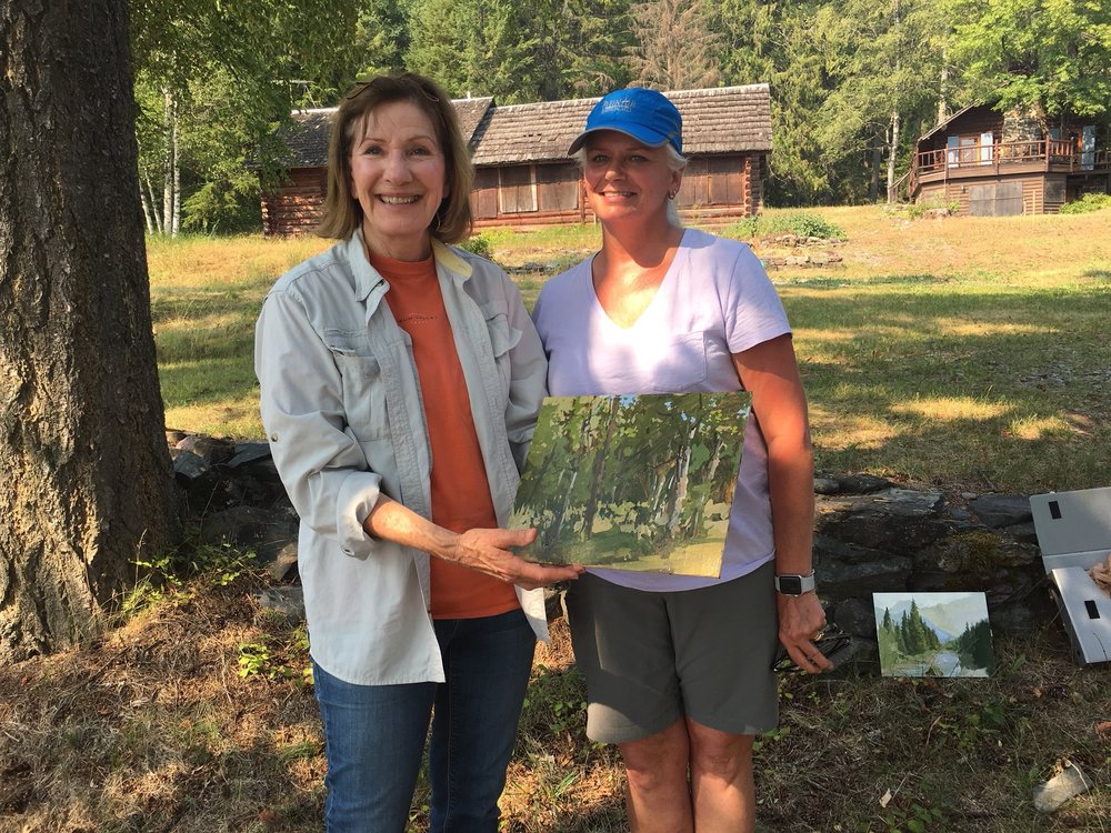 Gail holding the demonstration painting she purchased. Everything behind us burned.