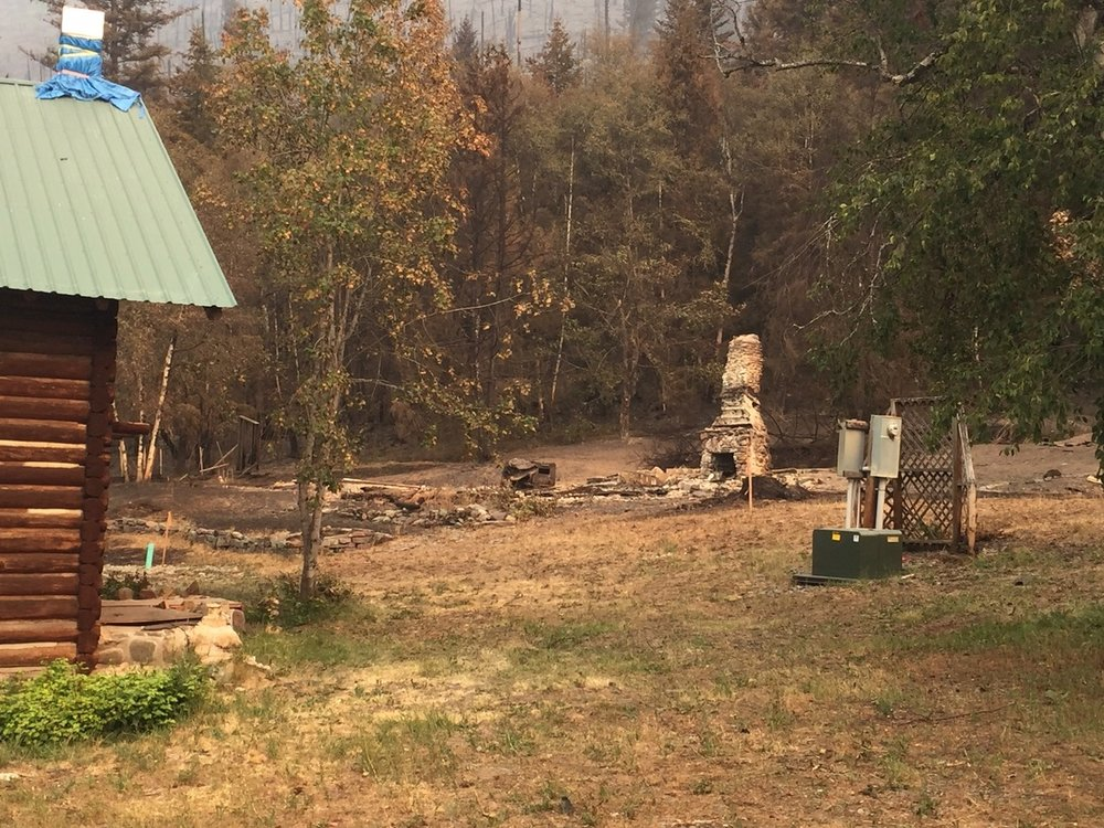 All that is left of one of the four cabins consumed by the fire.