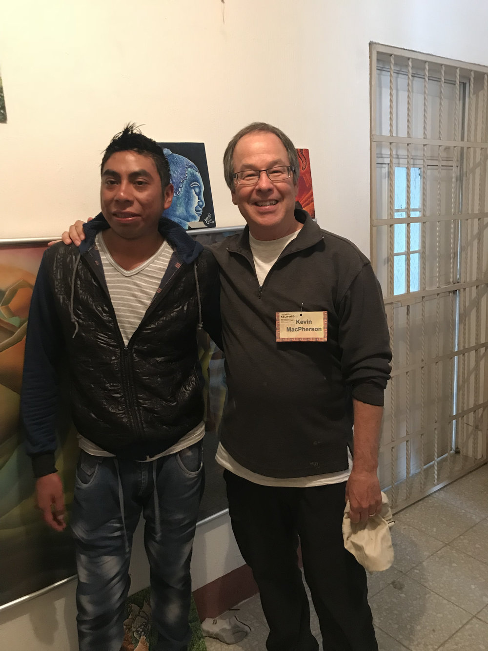 Kevin with art scholarship recipient, Lorenzo.