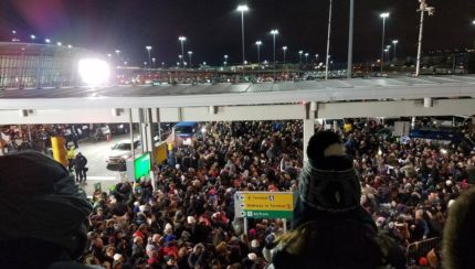 via socialistalternative.com.  Protests last night at JFK Airport in New York.   Mr. President, I think it's safe to say you have our attention.