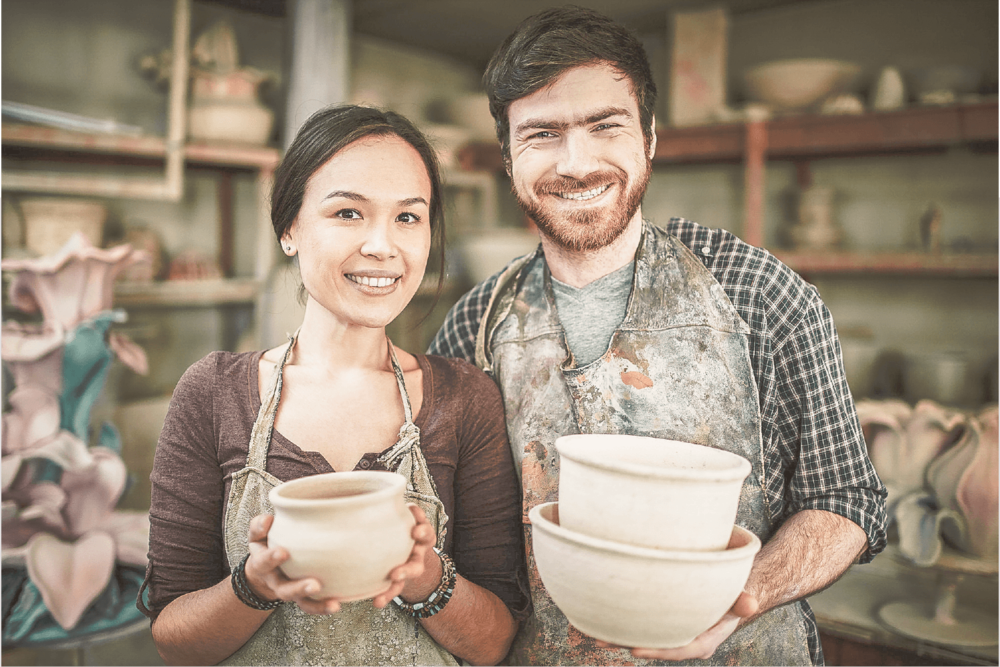 website design for makers, couple making pottery excited about starting a business and selling things