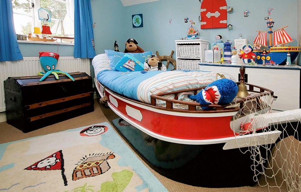 boat bed in a pirate themed bedroom