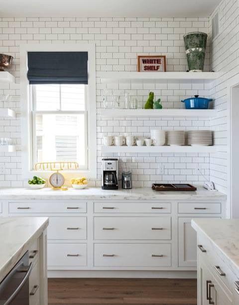 white kitchen with subway tile walls