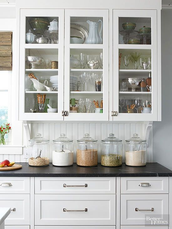 organised kitchen cabinet with glass doors