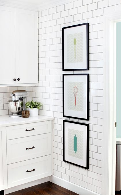 white kitchen with subway tile wall