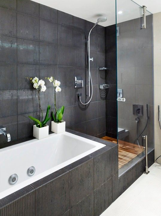 zen bathroom with dark wall tiles