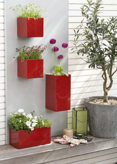 bright red wall planters
