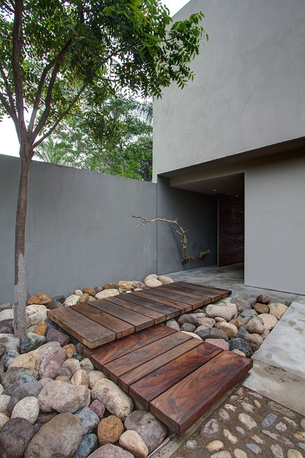 modern stone, wood and concrete front yard