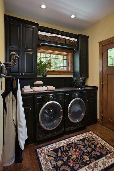 ornate black laundry room design