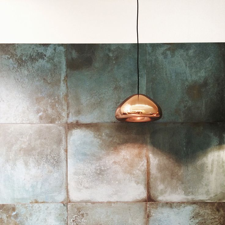 oxidized brass kitchen splashback