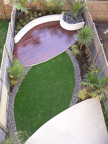 contemporary wood and grass small backyard design