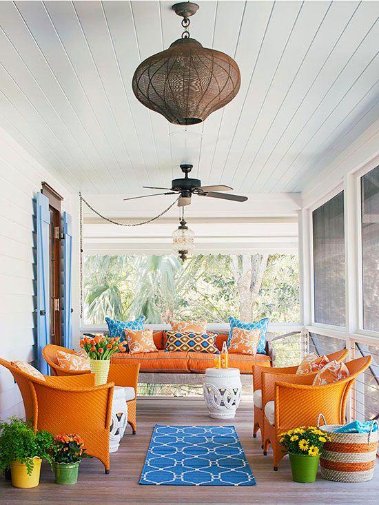 screened verandah with bright furniture