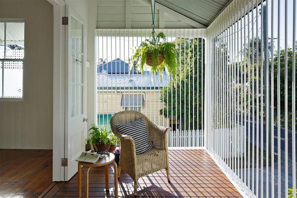 glass verandah with vertical blinds