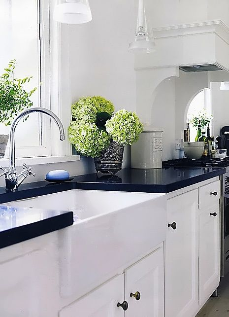 classic white kitchen with dark countertops