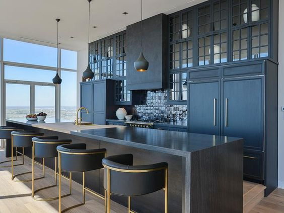 upscale dark kitchen with gold etchings