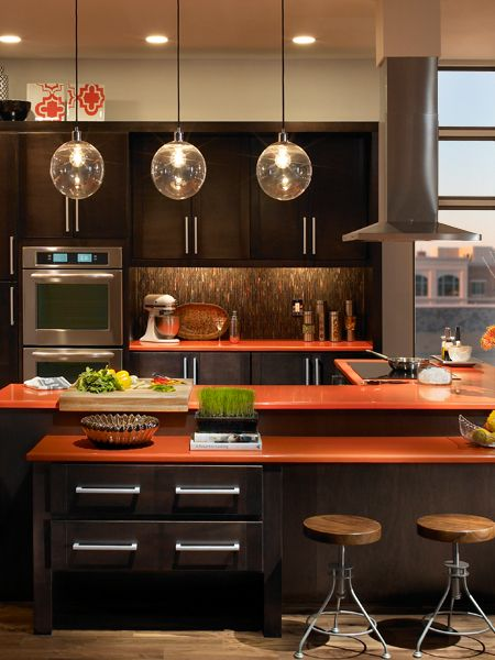 brown kitchen with orange countertops