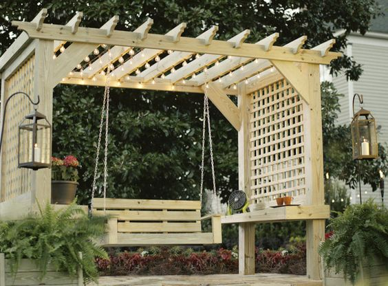 cosy wood pallet pergola with swing