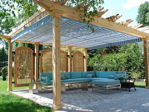 comfortable stand alone pergola with sofa and shades