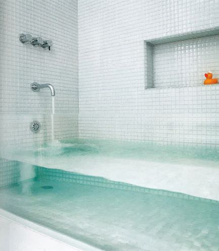 transparent glass bath tub