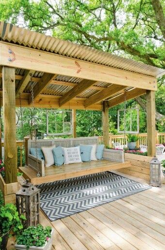 wooden pavilion with swing bed
