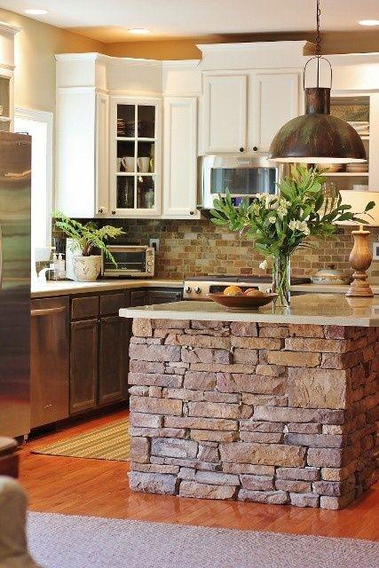 rustic kitchen with brick island and backsplash