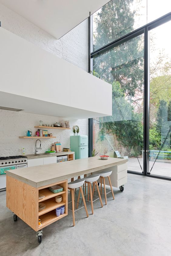 large airy kitchen with wheeled island