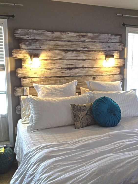 master bedroom with wood plank headboard
