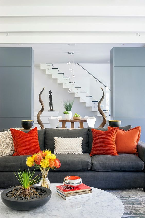 stylish grey and orange living room